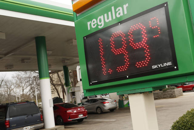 FILE - In this Jan. 8, 2019, file photo drivers fill up at the BP station on Prince Avenue in Athens, Ga. On Wednesday, Feb. 13, the Labor Department reports on U.S. consumer prices for January. (Joshua L. Jones/Athens Banner-Herald via AP, File)