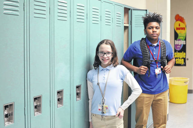Seventh-grader Kylee Joyner and eighth-grader Amarion Glenn found ways to accessorize with their uniforms at Lima North Middle School.