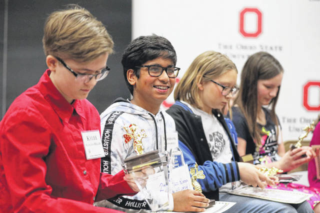 Third runner-up and St. Rose Middle School eighth-grader Kylee Mangini-Miller, Shashank Chanamonlu, a seventh-grader of Shawnee Middle School, Delphos Middle School sixth-grader Delilah Pavel, and Delphos Landeck School fifth-grader Olivia Bloom all received awards during the Allen County Spelling Bee on Saturday morning.