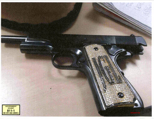 "FILE - This undated file photo provided by the U.S. Attorney's Office shows a diamond-encrusted pistol that a government witness said belonged to infamous Mexican drug lord Joaquin ""El Chapo"" Guzman, at Guzman's trial in New York. After El Chapo's conviction in the drug-trafficking trial that included florid testimony of jewel-encrusted guns, some Americans have floated an idea they see as poetic justice: Why not take some of the Mexican drug lord's billions in ill-gotten gains and make him pay for a border wall? (U.S. Attorney's Office via AP, File)"