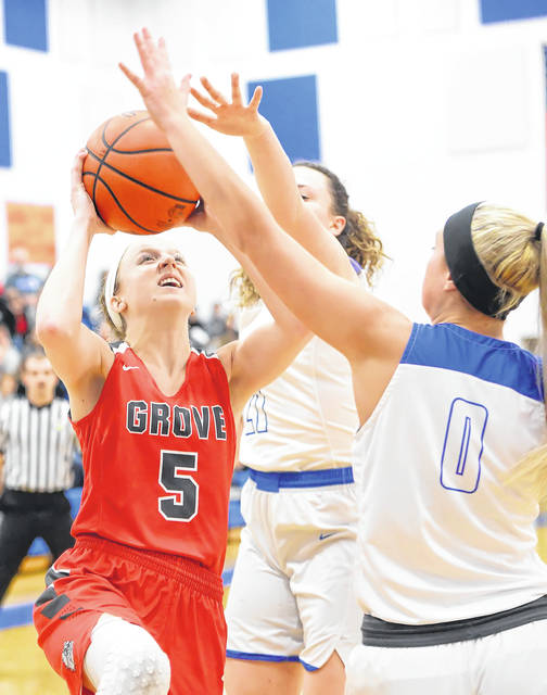 Columbus Grove's Rylee Sybert puts up a shot against Allen East's Tori Newland during Thursday night's Northwest Conference game at Allen East.