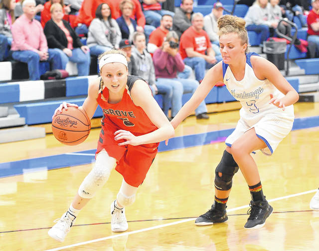 Columbus Grove's Rylee Sybert drives against Allen East's Ally Richardson during Thursday night's Northwest Conference game at Allen East.