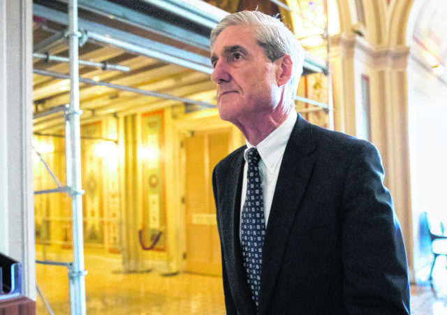 FILE - In this June 21, 2017, file photo, special counsel Robert Mueller departs after a meeting on Capitol Hill in Washington. Mueller is set to reveal more details about his Russia investigation as he faces court deadlines in the cases of two men who worked closely with President Donald Trump.