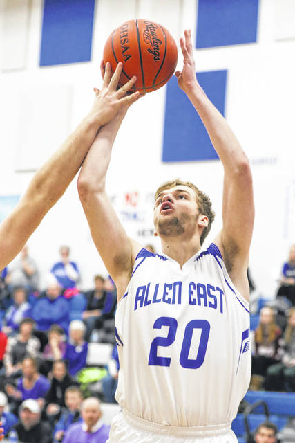 Allen East's Wayne Lowery puts up a shot during Tuesday night's game against Upper Scioto Valley at Allen East.