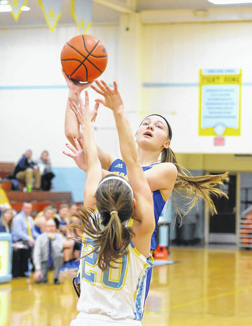 Ally Will of St. Marys puts up a shot against Bath's Tori Dackin during Thursday night's Western Buckeye League game at Bath.