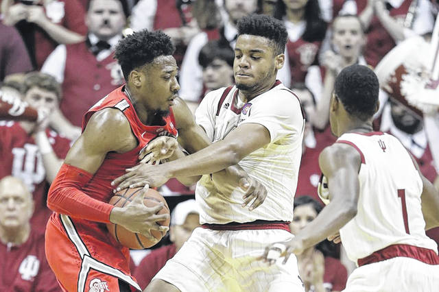 Ohio State's Andre Wesson, left, goes to the basket against Indiana's Juwan Morgan during the second half of an NCAA college basketball game, Sunday in Bloomington, Ind.