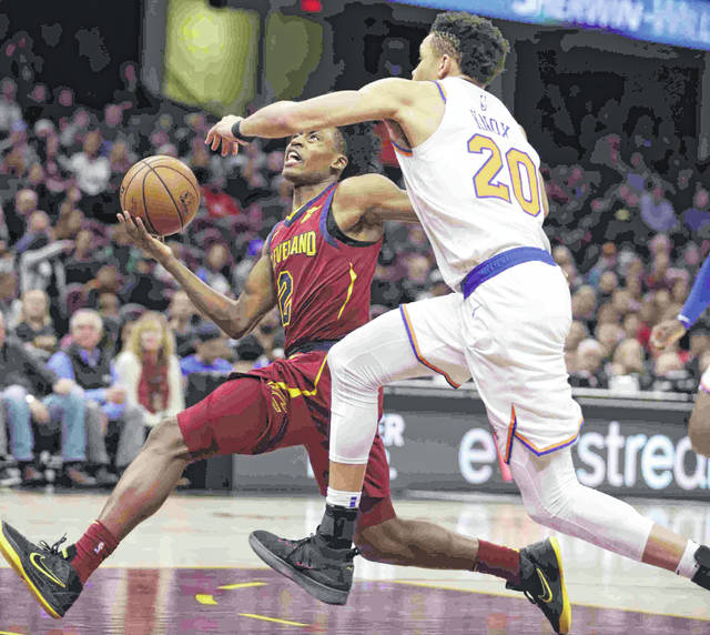 Cleveland Cavaliers' Collin Sexton (2) drives to the basket against New York Knicks' Kevin Knox (20) in the first half of an NBA basketball game, Monday.