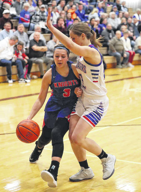 Crestview's Bailey Gregory drives against Wayne Trace's Sadie Sinn during a Division IV sectional final at Paulding.