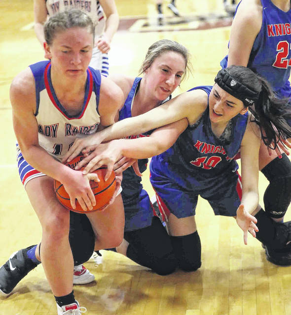 Crestview's Raegan Hammons, center, and Haley Speith try to pry the ball away from Wayne Trace's Miriam Sinn during a Division IV sectional final at Paulding.
