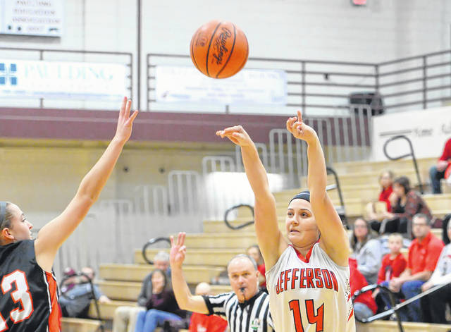 Delphos Jefferson's Aly Lindeman puts up a shot against Fort Jennings' Madison Neidert during a Tuesday night Division IV sectional game at Paulding High School.