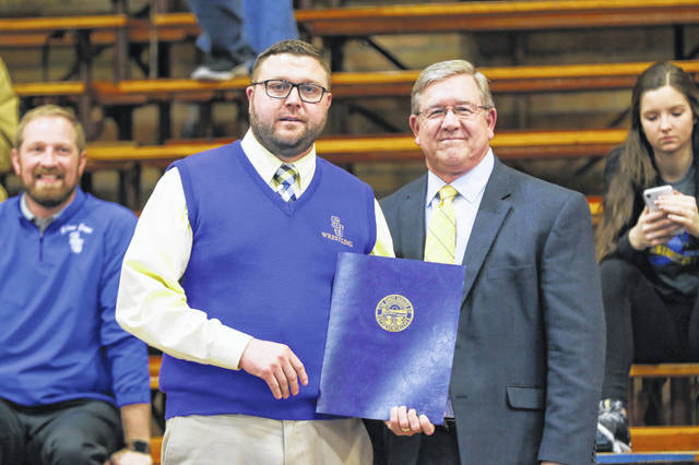 State Rep. Bob Cupp, right, presented an Ohio House proclamation Tuesday night to Delphos St. John's head wrestling coach Derek Sterling as the program marked 50 years prior to its home match against Spencerville.
