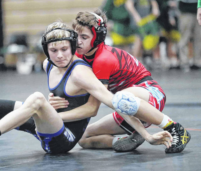 Allen East's Jordan Kennedy, left, competes against LCC's Gavin Caprella during Saturday's Division III Region 24 Dual Team Tournament at Coldwater High School.