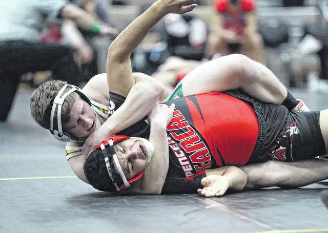 Spencerville's Ruben Noriega, front, battles Troy Christian's Craig Montgomery during Saturday's Division III Region 24 Dual Team Tournament at Coldwater High School.