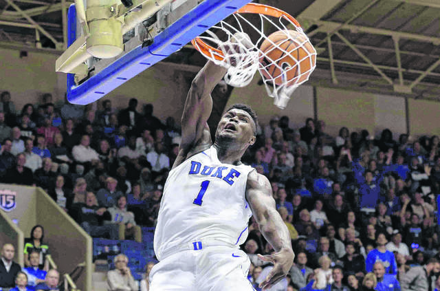 Duke's Zion Williamson (1) dunks against Eastern Michigan during a game earlier this season in the Blue Devils' Cameron Indoor Arena. With his mix of high-flying acrobatics on the court and his charismatic personality off it, Williamson has emerged as the natural face of the Blue Devils and college basketball as a whole.