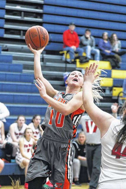 Elida's Hayleigh Bacome puts up a shot against Van Wert's Abby Jackson during Wednesday night's Division II sectional game in Miller City.