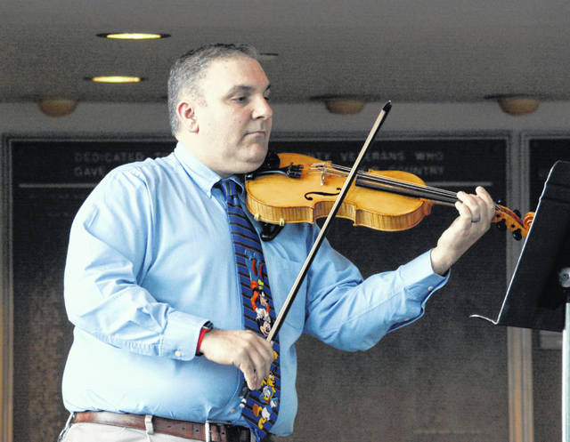 Joe Macbenn, elementary and middle school orchestra teacher, performs at last year's Evening With the Arts.