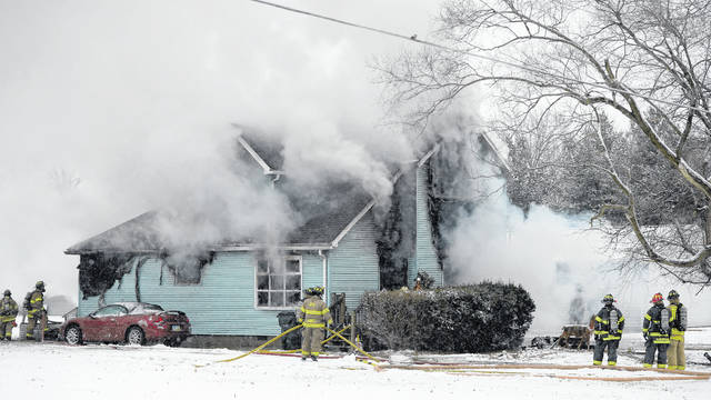 American Township Fire Department battle a house fire at 3082 Freyer Road on Sunday.