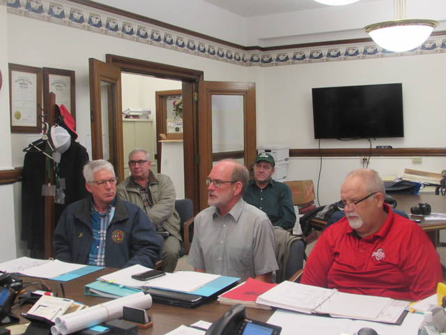 Pictured are Citizens United For A Better Blanchard members talking during Thursday's Putnam County Commissioners meeting about plans for flood mitigation on Blanchard River. Front row from left are are Jim Leopold, Dan Ellberbrock and Glenn Karhoff and back row from left, Joe Repienhoff and Jim Hoorman.