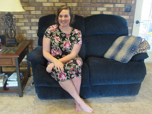Ottawa-Glandorf High School 2011 graduate Katie Laudick is pictured inside her parent's Ottawa home resting before her surgery Monday.