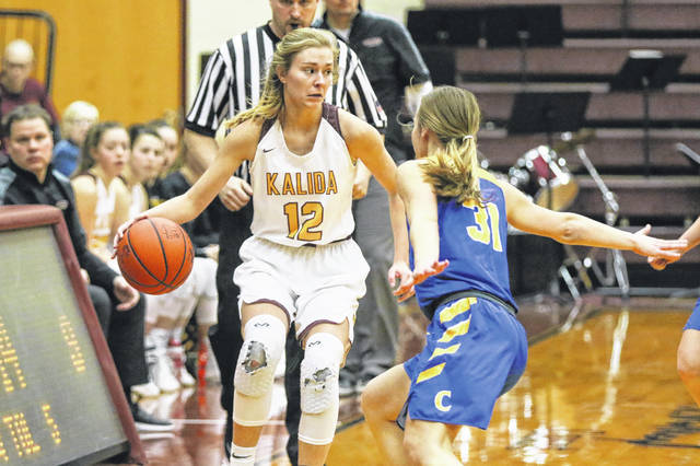 Continental's Alex Hoeffel guards Kalida's Lauren Langhals during Thursday night's Putnam County League game at Kalida.