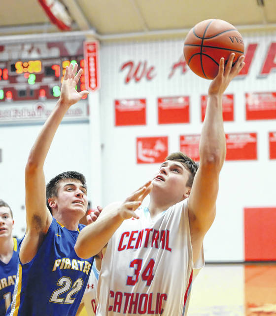 Lima Central Catholic's Michael Riepenhoff puts up a shot against Continental's Jaden Warner during a Tuesday night Division IV sectional game at Van Wert.