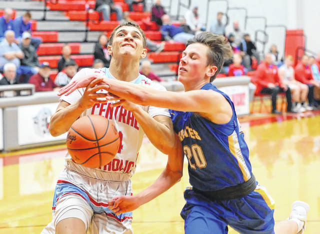 Continental's Mitchell Coleman, right, defends against Lima Central Catholic's Rossy Moore during a Tuesday night Division IV sectional game at Van Wert.