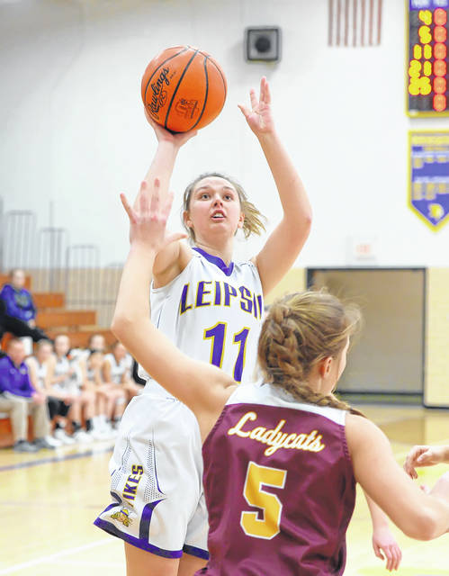 Leipsic's Bailee Sickmiller puts up a shot against Kalida's Grace Klausing during Saturday's Putnam County League game at Leipsic.