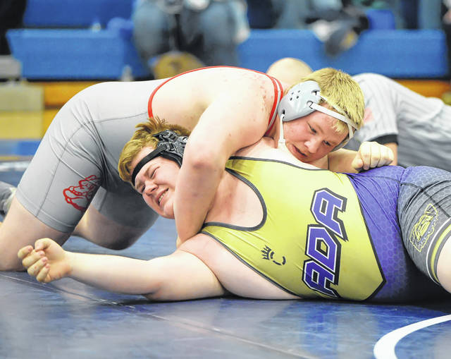 Columbus Grove's Jeff Meyer, top, competes against Ada's Noah Arnett during Saturday's Northwest Conference Tournament at Allen East.