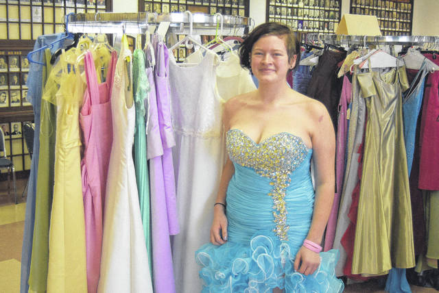 Cassandra Sterling models a dress she picked up from the Lima Kiwanis Club prom dress giveaway, Saturday.