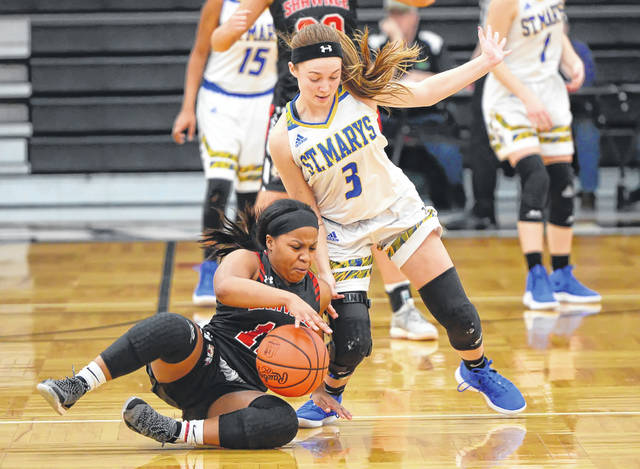 Shawnee's Samya Wright lands on the floor while trying to keep the ball away from St. Marys' Ally Will during a Saturday sectional final at Spencerville.