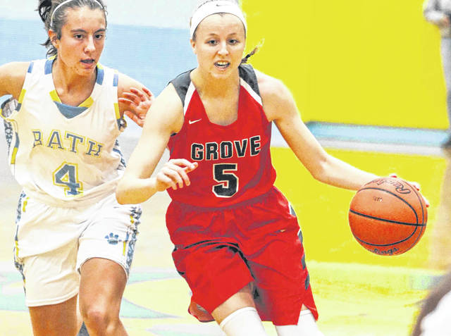 Rylee Sybert of Columbus Grove drives down the court as she is pursued by the defense of Bath's Abbie Dackin on Saturday afternoon at Bath.   Levi A. Morman | The Lima News
