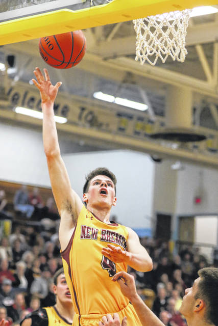 New Bremen's Mitchell Hays puts up a shot during a Tuesday night Division IV sectional game against Upper Scioto Valley at Bath.