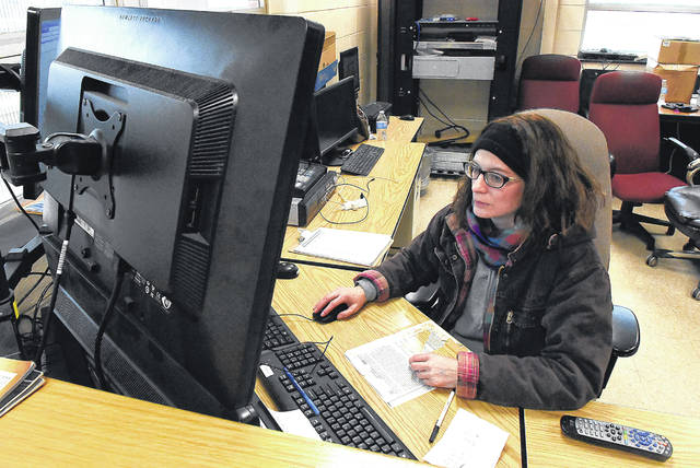 Jessica Preston, a wastewater operator for City of Lima's wastewater treatment plant, uses computers to operate the plant and lift stations.