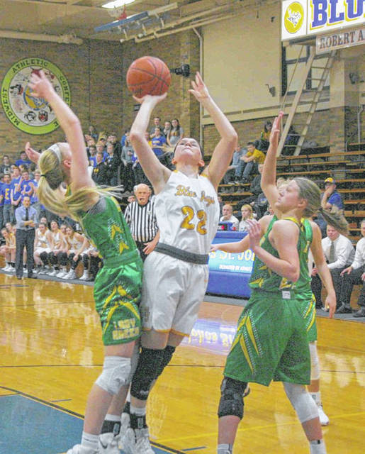 Betty Vorst of Delphos St. John's puts up a shot during Saturday night's game against Ottoville in Delphos.