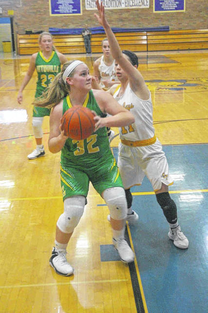 Ottoville's Kylee Hoersten positions herself inside against Paige Gaynor of Delphos St. John's during Saturday night's game in Delphos.