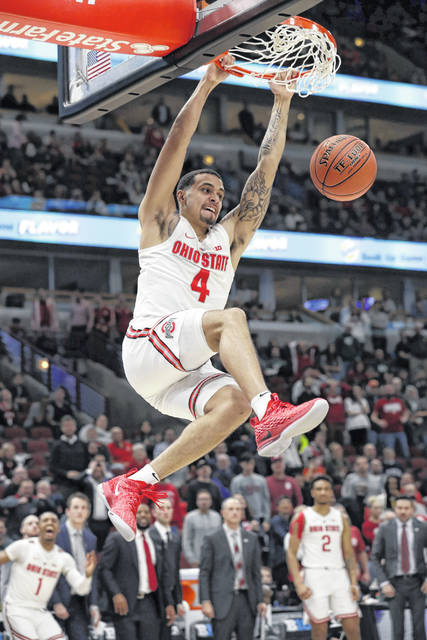 Ohio State's Duane Washington Jr. scores on a dunk during a Thursday Big Ten Conference tournament game against Indiana in Chicago.
