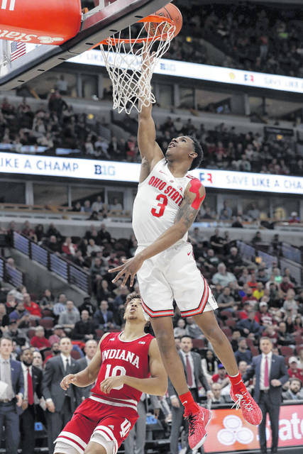 Ohio State's C.J. Jackson goes upon for a lay up against Indiana's Rob Phinisee during a Thursday Big Ten Conference tournament game in Chicago.