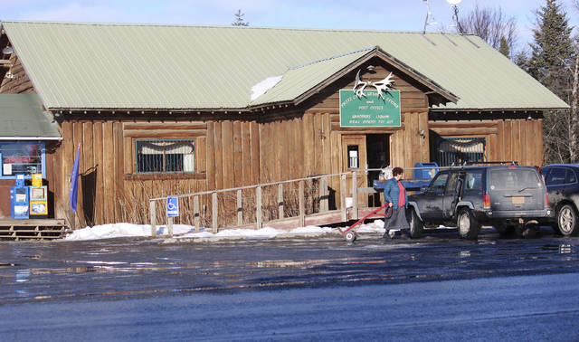 In this Feb. 26, 2019 photo is the Fritz Creek General Store, shown near Homer, Alaska. A cat named Stormy that has spent more than six years as a fixture in a remote Alaska general store is being forced out after officials notified the store owners that the cat's presence violates food safety standards. The Homer News reported Thursday, Feb. 28, 2019, that the Fritz Creek General Store near the small city of Homer has been home for Stormy since 2012. (Megan Pacer/Homer News via AP)