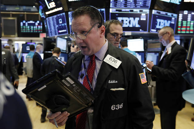 Trader Edward Curran, left, works on the floor of the New York Stock Exchange, Tuesday, March 5, 2019. Stocks are opening slightly lower on Wall Street led by losses in banks and technology companies. (AP Photo/Richard Drew)