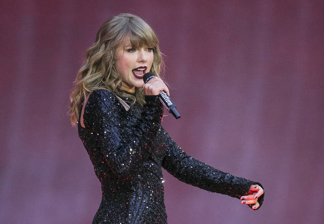 """FILE - In this June 22, 2018, file photo, singer Taylor Swift performs on stage in concert at Wembley Stadium in London.  Swift says she turns off comments on social media to """"block some of the noise.""""  That's one of the lessons she's learned that the singer outlined Wednesday, March 6, 2019 in an Elle magazine article about her turning 30 this year.  (Photo by Joel C Ryan/Invision/AP, File)"""
