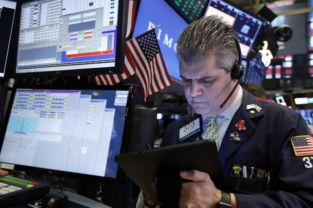 FILE- In this Feb. 15, 2019, file photo trader John Panin works on the floor of the New York Stock Exchange. The U.S. stock market opens at 9:30 a.m. EST on Wednesday, March 6. (AP Photo/Richard Drew, File)