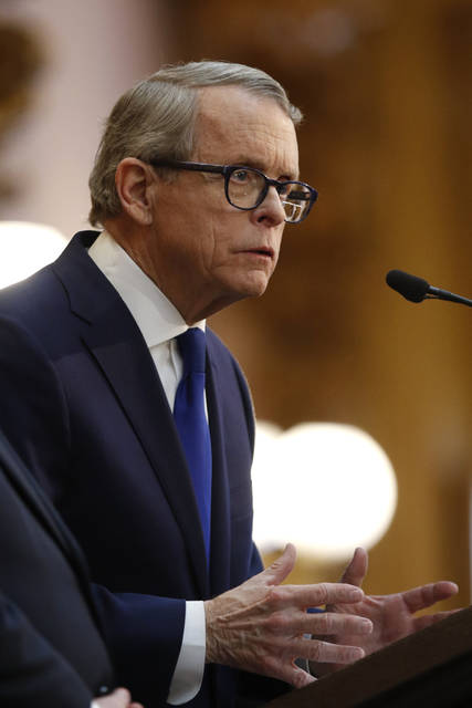 Ohio Governor Mike DeWine speaks during the Ohio State of the State address at the Ohio Statehouse in Columbus Tuesday.