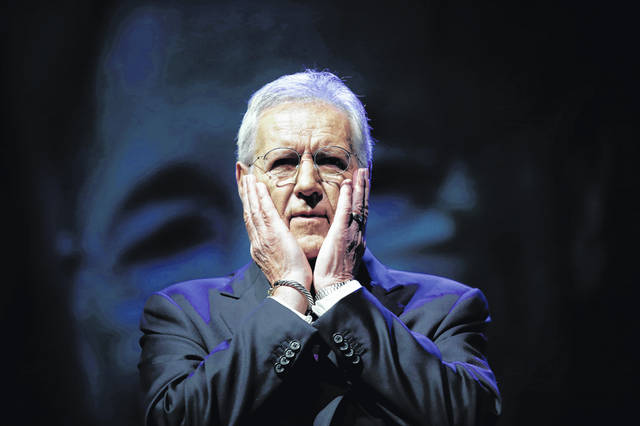 """Moderator Alex Trebek speaks during a gubernatorial debate in Pennsylvania. The """"Jeopardy!"""" host says he has been diagnosed with advanced stage four pancreatic cancer."""