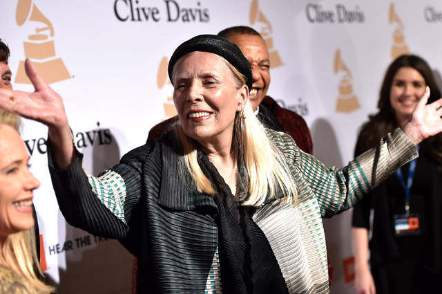 "FILE - In this Feb. 7, 2015 file photo, Joni Mitchell arrives at the 2015 Clive Davis Pre-Grammy Gala in Beverly Hills, Calif. Mitchell's ""Morning Glory On the Vine: Early Songs and Drawings,"" will be published Oct. 22, 2019. (Photo by John Shearer/Invision/AP, File)"