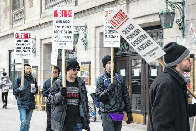 Musicians of the Chicago Symphony Orchestra go on strike and walk the picket line outside the doors of Orchestra Hall on Michigan Avenue on Monday.