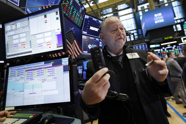 Trader Robert Moran works on the floor of the New York Stock Exchange, Monday, March 11, 2019. Stocks are opening broadly higher on Wall Street, although a sharp drop in Boeing is pushing the Dow Jones Industrial Average lower. (AP Photo/Richard Drew)