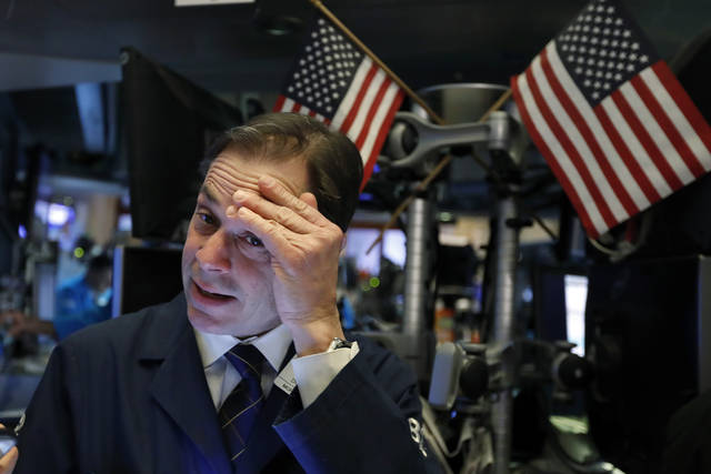 Trader Dudley Devine works on the floor of the New York Stock Exchange, Tuesday, March 12, 2019. Another slide in Boeing weighed on the Dow Jones Industrial Average. (AP Photo/Richard Drew)