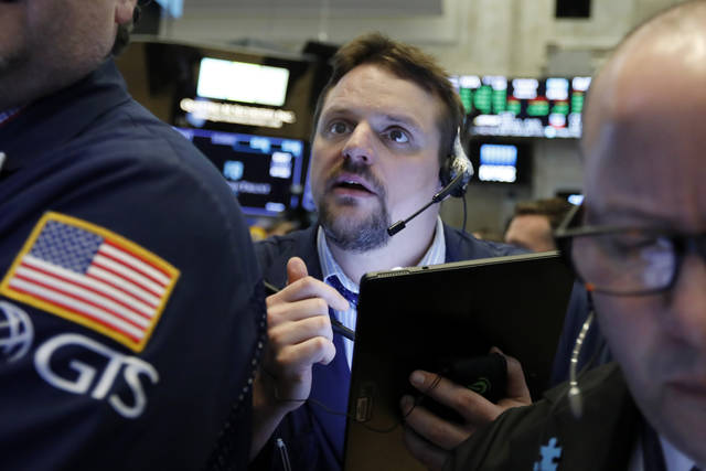 Trader Michael Milano works on the floor of the New York Stock Exchange, Tuesday, March 12, 2019. Another slide in Boeing weighed on the Dow Jones Industrial Average. (AP Photo/Richard Drew)