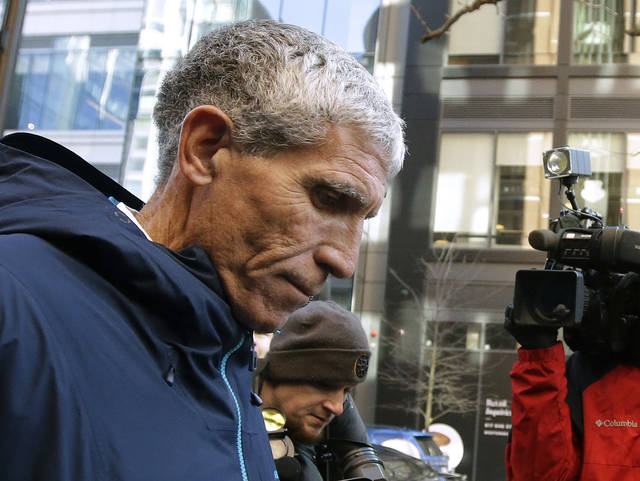 "William ""Rick"" Singer founder of the Edge College & Career Network, departs federal court in Boston on Tuesday, March 12, 2019, after he pleaded guilty to charges in a nationwide college admissions bribery scandal. (AP Photo/Steven Senne)"