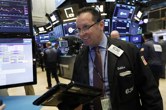 Trader Edward Curran works on the floor of the New York Stock Exchange, Wednesday, March 13, 2019. U.S. stocks opened broadly higher on Wall Street Wednesday, powered by technology and health care companies, as the market pushes for its third straight day of gains. (AP Photo/Richard Drew)